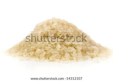 Pile of organic rice (on white) - stock photo