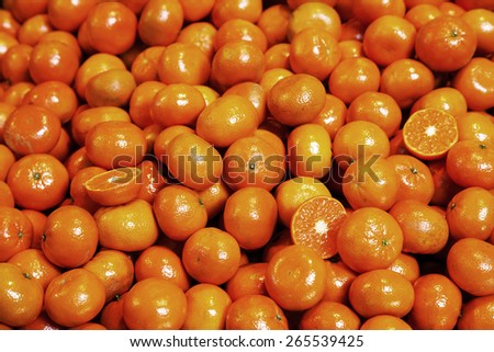 pile of organic tangerines at market stall - stock photo