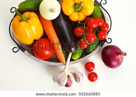 Pile of organic vegetables on a rustic wooden table