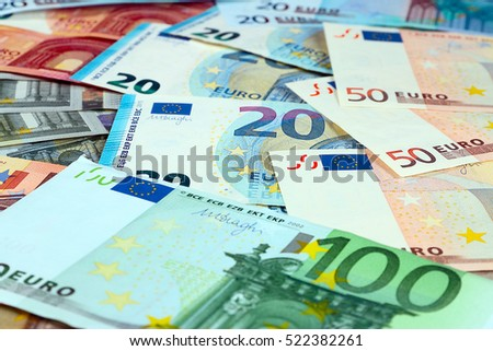 pile of paper euro banknotes as part of the united country's payment system