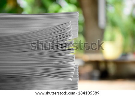 pile of papers green background - stock photo