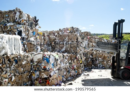 Pile of papers in a recycle center  - stock photo
