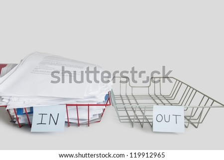 Pile of papers in office tray over white background - stock photo