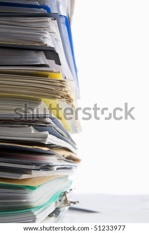 Pile of paperwork shot against white background - stock photo