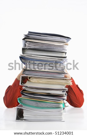 Pile of paperwork with stress businessman on back, over white background