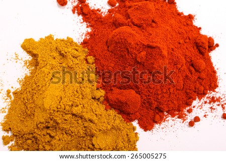 Pile of paprika and pepper powder - stock photo
