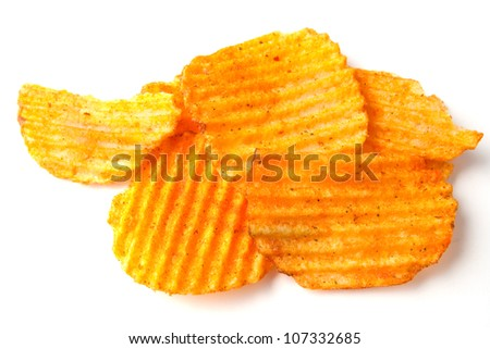 Pile of paprika chips on white