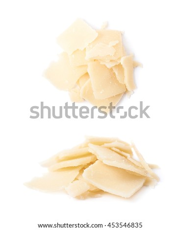 Pile of parmesan cheese flakes isolated over the white background, set of two different foreshortenings - stock photo