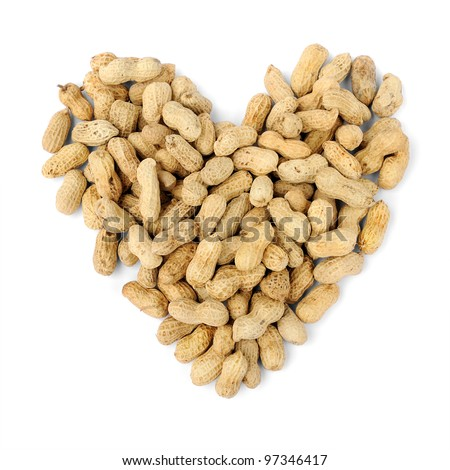 Pile of peanuts in heart shape isolated on a white background, selective focus. - stock photo