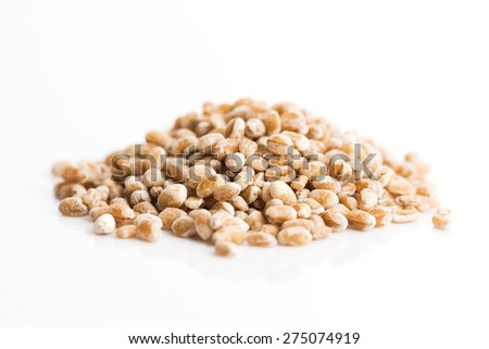 pile of pearl barley isolated on white - stock photo