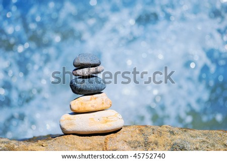 Pile of pebble on the background of water drops