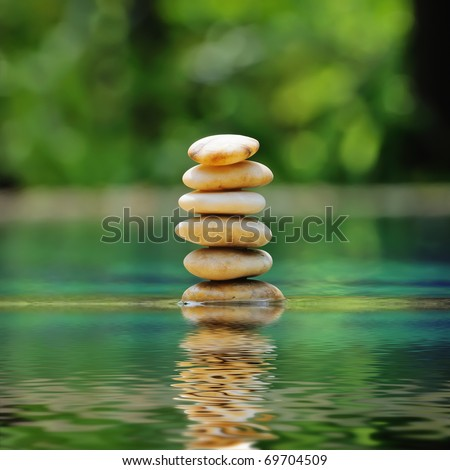 Pile of pebble stones against mysterious background - stock photo