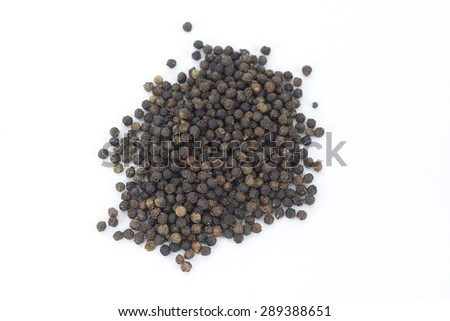 Pile of peppercorns on a white background