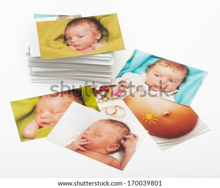 Pile of photographs on white background - stock photo