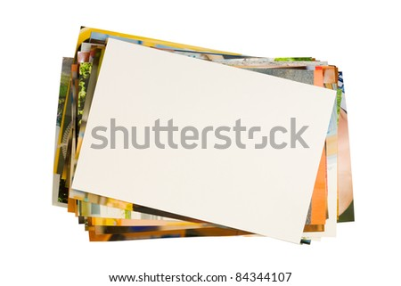 Pile of photographs with empty frame for your photo isolated on white background