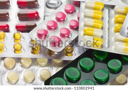 Pile of pills in blister packs - stock photo