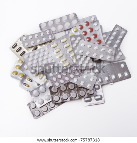 pile of pills in blister packs - stock photo