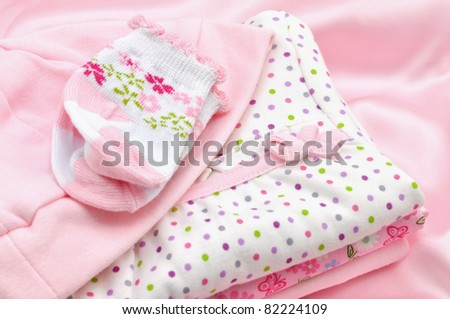 Pile of pink baby clothes - stock photo