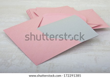 pile of pink envelopes on the table - stock photo