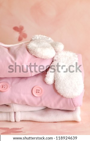 Pile of pink girlie warm winter clothes - stock photo