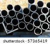 Pile of pipes - stock photo