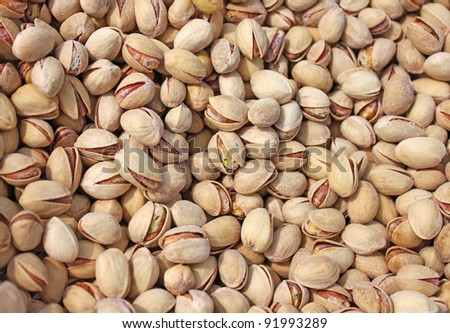 Pile of pistachio nuts in shells