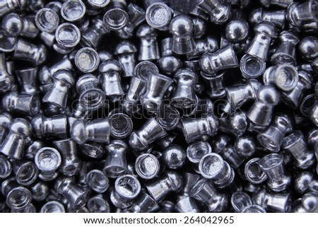 Pile of pistol and rifle cartridges - stock photo