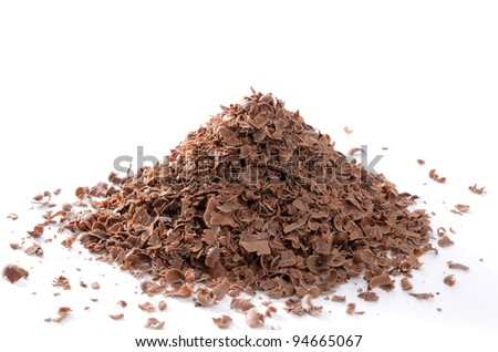 Pile of planed chocolate on white background