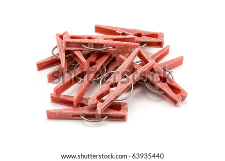 pile of plastic clothes pegs on white background