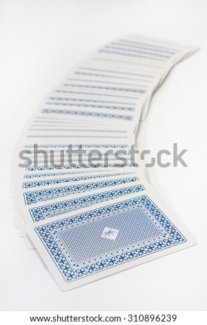 Pile of playing cards on the white background.