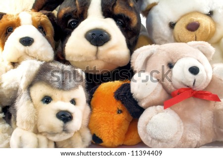 Pile of plush animals with dogs and teddies - stock photo