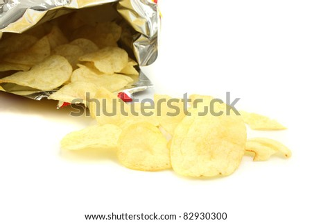 Pile of potato chips isolated on white background - stock photo