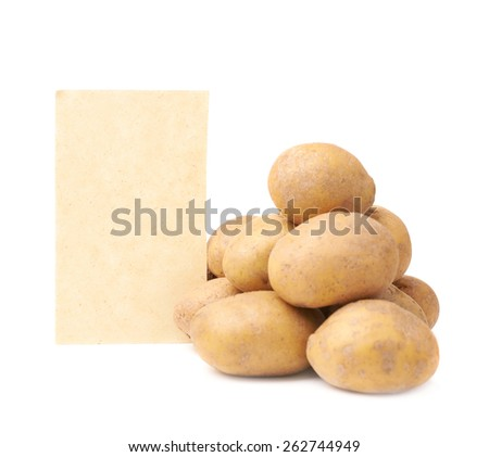 Pile of potatoes lying against the copyspace brown piece of paper, composition isolated over the white background - stock photo