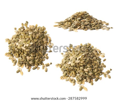 Pile of pumpkin seeds isolated over the white background, set of three different foreshortenings - stock photo