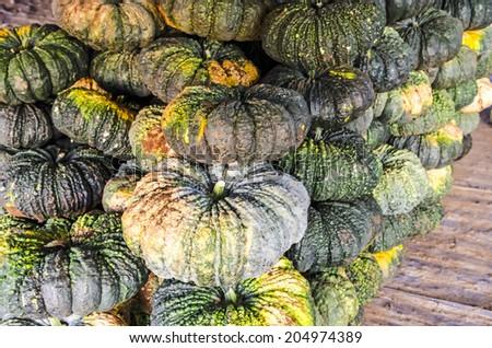 Pile of pumpkins in market  - stock photo