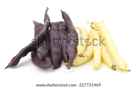 Pile of purple and white string beans isolated on white - stock photo