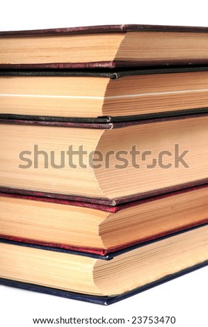Pile of ragged old books on the white background