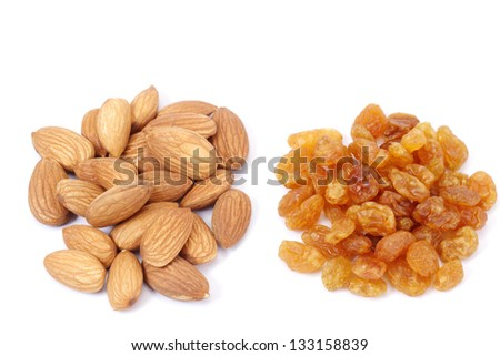 Pile of  raisins and almonds on white - stock photo