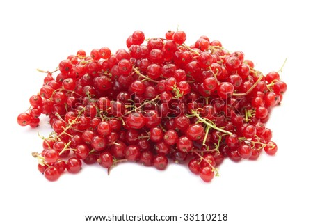 Pile of raspberries currants isolated on white background.