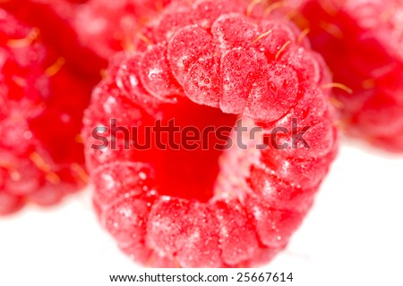 pile of raspberry with water drops macro - stock photo