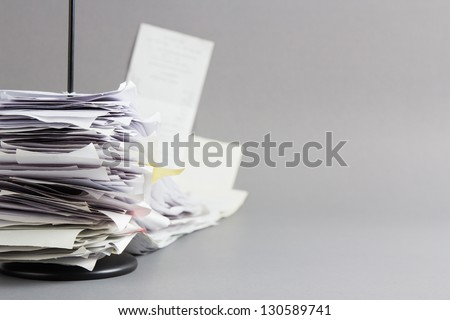 Pile of receipts in paper nail - stock photo