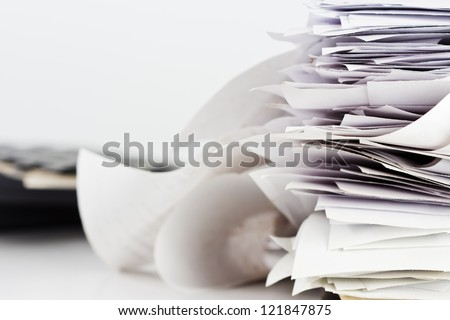 Pile of receipts on the desk - stock photo