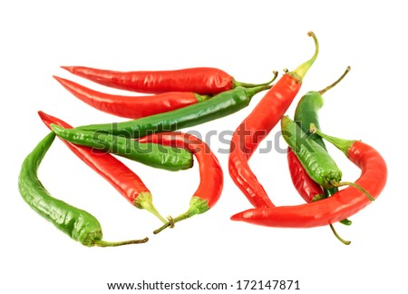 Pile of red and green chili peppers isolated over white background - stock photo