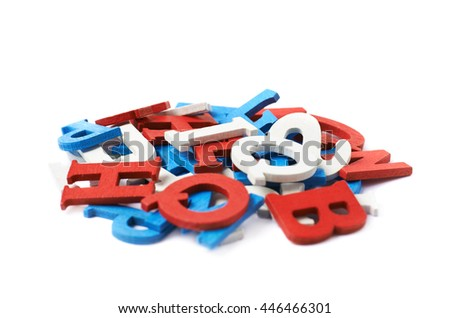 Pile of red, blue, white painted wooden letters isolated over the white background - stock photo