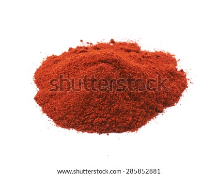 Pile of red chili paprika powder isolated over the white background