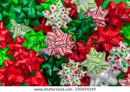 Pile of red, green and white Christmas bows background - stock photo