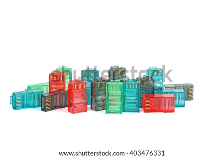 Pile of red, green, blue and black RJ45 connectors isolated on white background - stock photo