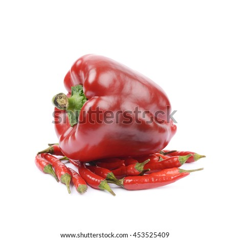 Pile of red italian peppers with a bell pepper over it, composition isolated over the white background - stock photo