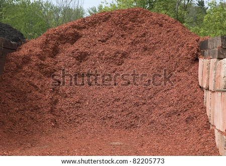 pile of red mulch for landscaping - stock photo