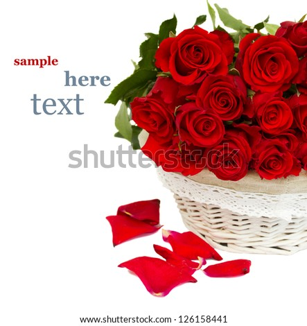 pile of red roses in basket